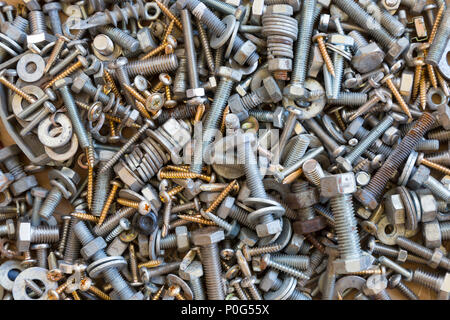 A random pile of nuts,bolts and screws for backgrounds. - Stock Photo
