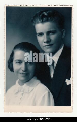 HODONIN, THE CZECHOSLOVAK REPUBLIC, CIRCA 1935: A young couple - vintage studio photo, circa 1935. - Stock Photo