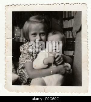 HODONIN, THE CZECHOSLOVAK REPUBLIC, CIRCA 1935: The small girls - vintage photo, circa 1935. - Stock Photo