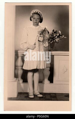 HODONIN, THE CZECHOSLOVAK REPUBLIC, CIRCA 1930: Vintage photo of a young girl -  her first holy communion, circa 1930. - Stock Photo