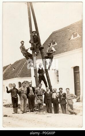 THE CZECHOSLOVAK REPUBLIC, CIRCA 1930: Vintage photo of electricians. Building of power lines, circa 1930. - Stock Photo