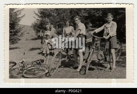 THE CZECHOSLOVAK REPUBLIC, CIRCA 1930: Vintage photo of a family on the trip, circa 1930. Young cyclists. - Stock Photo