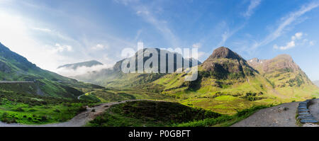 Panorama of mist covered Glencoe , the Highlands, Scotland , the United Kingdom taken on the sunny spring morning - Stock Photo