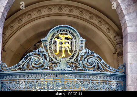 Limoges, France - September 28, 2017: Architectural details on building, aesthetic frills. Monogram of the house owner on grid iron gate - Stock Photo