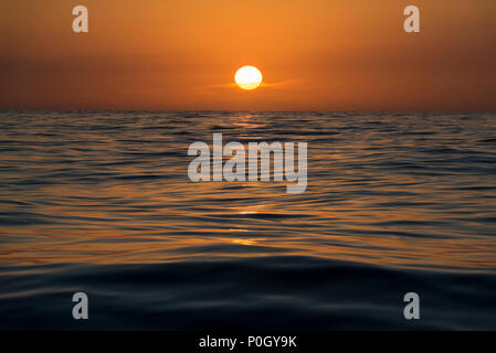 colours of the water in the early morning light, as the sun rises, seen from a yacht sailing in the North Atlantic Ocean. - Stock Photo