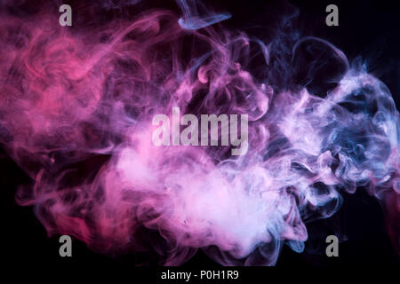 Colorful pink and blue smoke  on a black isolated background. Background from the smoke of vape - Stock Photo
