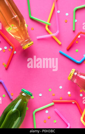 Various cold drinks with straws and confetti on bright pink background and copy space for text. Summer party, happy vacation and fun concept, top view - Stock Photo