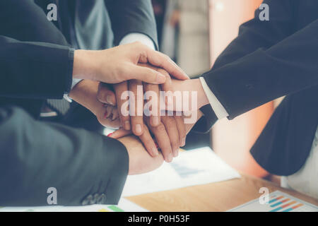 Dramatic moment.Split tone instragram like process.With hot light. People Hand Assemble Corporate Meeting Teamwork Concept - Stock Photo