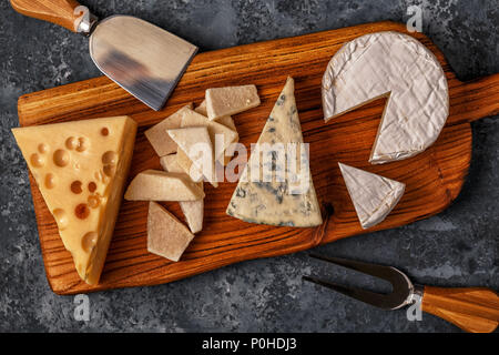 Assorted cheeses on wooden board, top view, copy space. - Stock Photo