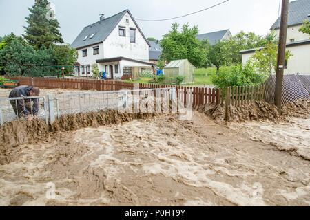 09 June 2018, Germany, Gehringswalde: Brown water masses force their way through streets after heavy rainfalls occurred in the region. Photo: Andre März/dpa-Zentralbild/dpa - Stock Photo