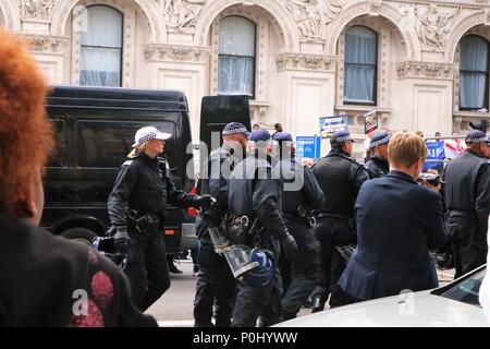 London, UK. 9th June 2018. Free Tommy Robinson March in London, UK with thousands of people marching and waving flags and plaques, police also in attendance at this event with riot wear. Credit: Michelle Bridges/Alamy Live News - Stock Photo
