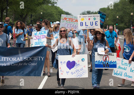 Washington DC, USA. 9th June 2018. Protestors carry signs up 16th Street NW during the March For The Ocean in Washington, D.C., June 9, 2018. The inaugural March for the Ocean called attention to ocean issues including plastic pollution and overfishing at events in the U.S. Capital and around the United States. Credit: Robert Meyers/Alamy Live News - Stock Photo