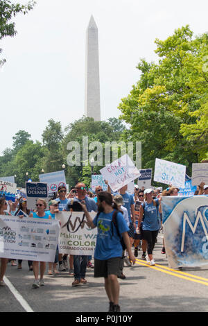 Washington DC, USA. 9th June 2018. Protestors carry signs on 16th Street NW near the Washington Monunment on the March For The Ocean in Washington, D.C., June 9, 2018. The inaugural March for the Ocean called attention to ocean issues including plastic pollution and overfishing at events in the U.S. Capital and around the United States. Credit: Robert Meyers/Alamy Live News - Stock Photo