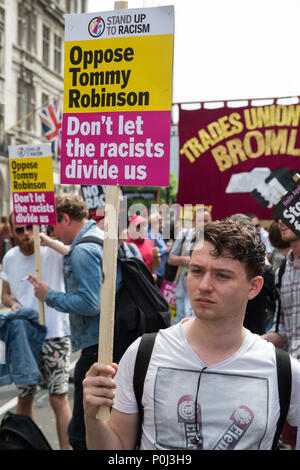London, UK. 9th June, 2018. Anti-fascists protest against the far-right March for Tommy Robinson in Parliament Street. Tommy Robinson was jailed for contempt of court after using social media to broadcast details of a trial subject to blanket reporting restrictions. Credit: Mark Kerrison/Alamy Live News - Stock Photo