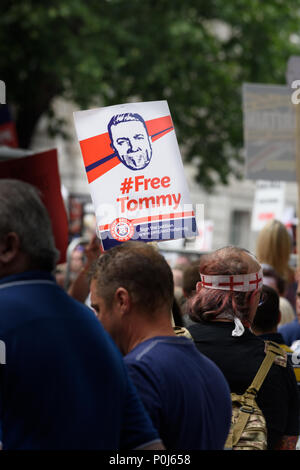 London, UK. 9th June 2018. People protesting about the imprisonment of Tommy Robinson gather in Whitehall, outside Downing street, London, England, to express their views on 9th June 2018, the day of the Queen's birthday celebrations. Credit: Michael Foley/Alamy Live News - Stock Photo
