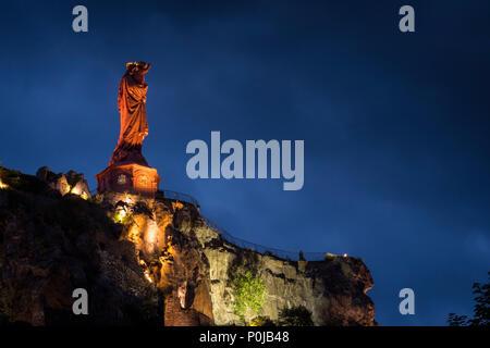 Statue of Notre Dame de France Le Puy en Velay Haute-Loire Auvergne-Rhône-Alpes France lit at night - Stock Photo