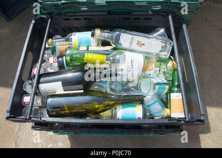 Collection of empty glass bottles waiting collection to a recycling centre - John Gollop - Stock Photo
