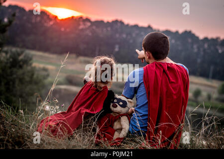 little girl with dad dressed in super heroes, happy loving family - Stock Photo