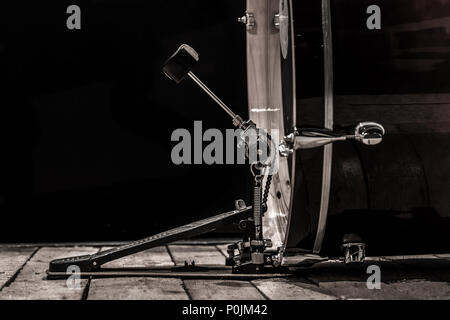 percussion instrument, bass drum with pedal on wooden boards with a black background - Stock Photo