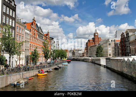 Wide angle photo from Flower Market (Bloemenmarkt), the world's only floating flower market founded in 1862, attracting many tourist from the world. - Stock Photo