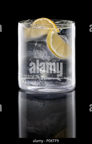 Gin and tonic in Rocks glass isolated on black - Stock Photo