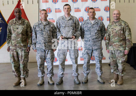 New York Air National Guard Airmen from the 107th Attack Wing Team 1 accept the Sgt. Reidar Waaler Team Combat Rifle Match 1st Place Award from Brig. Gen. Michel Natali, commander of the 53rd Troop Command, and Command Sgt. Maj. Corey Cush, senior enlisted advisor of the 53rd Troop Command, New York Army National Guard, following the 39th Annual Adjutant General's Marksmanship Competition at Camp Smith Training Site, N.Y., June 3, 2018. The three-day event features multiple marksmanship challenges in which troops from the New York Army and Air National Guards, Naval Militia, and State Guard ar - Stock Photo