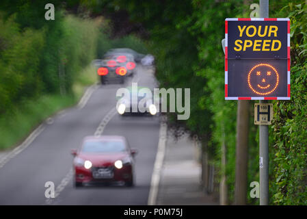 digital speed warning sign showing sad face when passing drivers are over the speed limit bramhope leeds united kingdom - Stock Photo