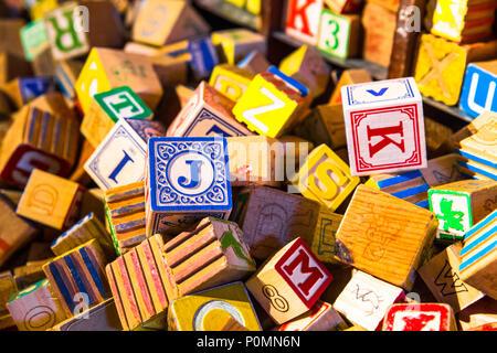 Pile of colorful children's vintage alphabet wooden block toys - Stock Photo