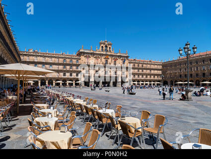 Salamanca, Spain. Cafes in the Plaza Mayor looking towards the City Hall (Ayuntamiento), Salamanca, Castilla y Leon, Spain