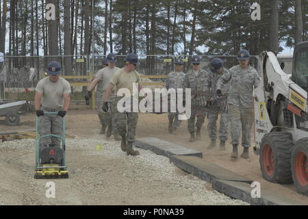 Service members from the 110th Attack Wing Civil Engineer Squadron, Battle Creek Air National Guard Base, Mich., carry constructed rebar cages for foundation and slab reinforcement, Tuesday, June 5, 2018, at Ādaži Military Base, Latvia, as part of their annual Deployment For Training (DFT). The 110th Civil Engineer Squadron is the fourth Air National Guard rotation supporting the 435th Construction and Training Squadron, Ramstein AB, Germany. The U.S. Air Forces in Europe (USAFE) exercise-related construction projects are intended to provide temporary housing for exercise participants from the - Stock Photo