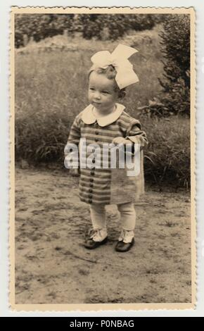 THE CZECHOSLOVAK REPUBLIC, CIRCA 1942: Vintage photo shows a small girl, circa 1942. - Stock Photo