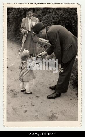 THE CZECHOSLOVAK REPUBLIC, CIRCA 1942: Vintage photo shows a small girl with toy during a walk, circa 1942. - Stock Photo