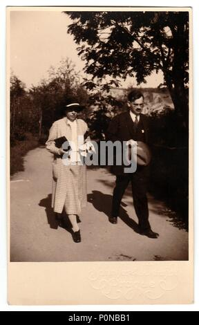 THE CZECHOSLOVAK REPUBLIC, CIRCA 1930s: Vintage photo shows mother and her son who go for a walk, circa 1930s. - Stock Photo
