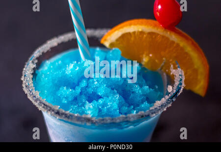 close up of a delicious frozen drink called a blue whale, with ice, lemonade, citrus vodka and curacao blue - Stock Photo