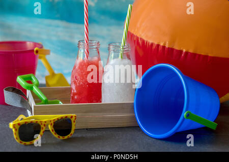 frozen lemonade and strawberry slush for kids, a great hit at the beach on a hot summer's day - Stock Photo