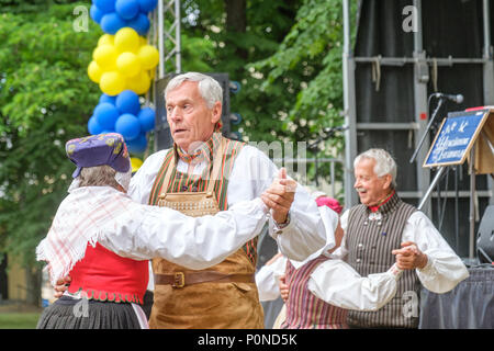 Swedish folk dance during National day celebration in the Olai Park of Norrkoping. Norrkoping is a historic industrial town in Sweden. - Stock Photo
