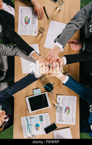 Cropped view of business partners at table in office, businesspeople teamwork collaboration relation concept - Stock Photo