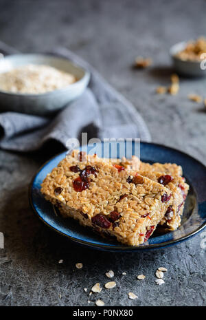 Healthy granola bars with cranberries, walnuts, sunflower seeds and raisins - Stock Photo