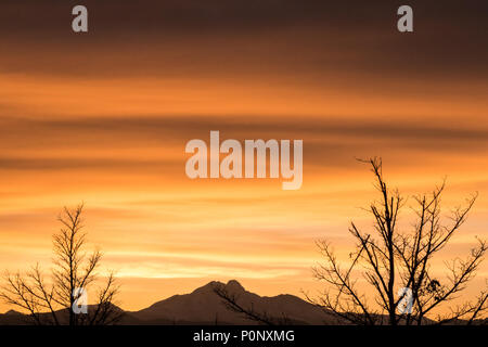 Spectacular sunset colors over the Front Range of the Rocky Mountains near Denver, Colorado, USA - Stock Photo
