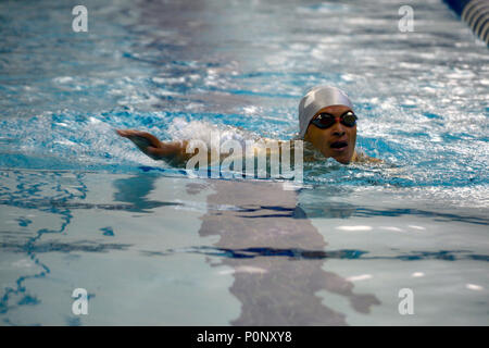 Army Spc. Vairon Caicedo Ocampo from Team SOCOM swims in the 50-meter race during the 2018 Warrior Games held at the Air Force Academy in Colorado Springs June 8, 2018. Created in 2010, the DoD Warrior Games introduce wounded, ill and injured service members and veterans to Paralympic-style sports. Warrior Games showcases the resilient spirit of today's wounded, ill or injured service members from all branches of the military. These athletes have overcome significant physical and behavioral injuries and prove that life can continue after becoming wounded, ill or injured.  (Photo by Michael Bot - Stock Photo