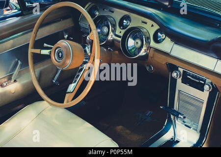 Berlin, Germany - june 09, 2018: Steering wheel, dashboard and interior of Ford Mustang vintage car cockpit at  Oldtimer  event for vintage cars and   - Stock Photo