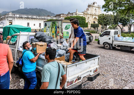 Antigua,, Guatemala -  June 5, 2018:  Volunteers load aid supplies to take to area affected by eruption of Fuego volcano on June 3 - Stock Photo