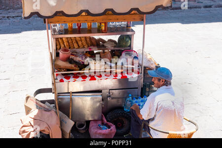 Vendor selling from a food cart in San Miguel de Allende, Mexico - Stock Photo
