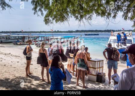 Speedboat to Bali from Gili Trawangan and Lombok, backpackers waiting to embark, Gili  Trawngan, Indonesia, April 26, 2018 - Stock Photo