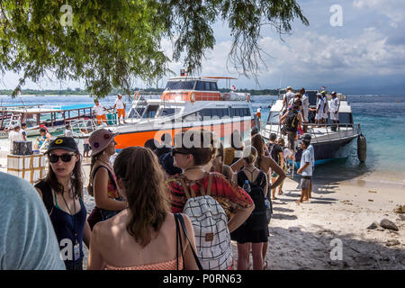 Speedboat to Bali from Gili Trawangan and Lombok, tourists standing in line, Indonesia, April 26, 2018 - Stock Photo