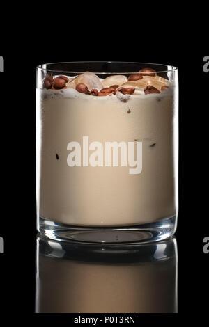 Irish cream cocktail in Rocks glass isolated on black - Stock Photo