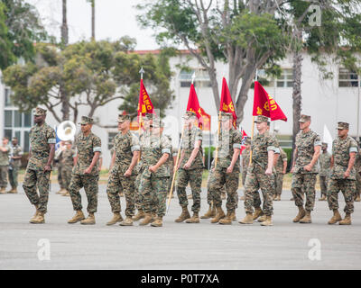 U.S. Marines with 3rd Assault Amphibian Battalion, 1st Marine Division march during a relief and appointment, and retirement ceremony for Sgt. Maj. Christopher Slattery on Camp Pendleton, Calif., May 5, 2017. Sgt. Maj. Slattery relinquished his post as Sgt. Maj. of 3rd Assault Amphibian Battalion, 1st Marine Division before retiring after serving honorably for 30 years. - Stock Photo
