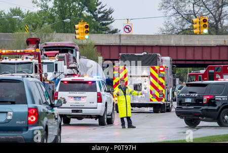 May 18 2018 Stevensville MI USA;  A police officer in rain gear directs traffic at the scene of a bad accident - Stock Photo
