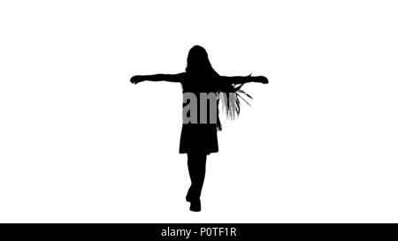Silhouette Dancing little blond girl singing track matte - Stock Photo