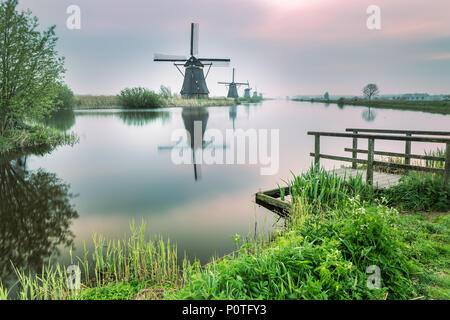 Windmill reflected in the canal Kinderdijk Rotterdam South Holland Netherland Europe - Stock Photo